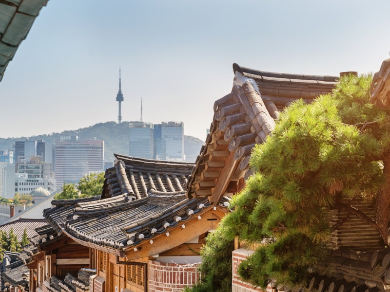 Bukchon Hanok Village  with view to downtown Seoul skyline and N Seoul Tower. Photo: iStock