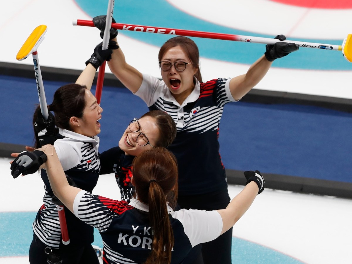 The South Korean women's curling team celebrate after beating Japan. Photo: Reuters / Cathal Mcnaughton