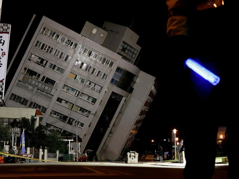 A police officer stands guard outside the partially collapsed Marshal Hotel after an earthquake hit Hualien, Taiwan late February 7, 2018. Photo: Reuters/TyroneSiu