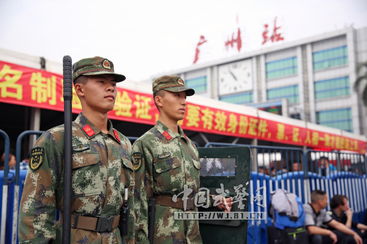PLA soldiers stand guard at an entrance to the Guangzhou Railway Station. Photo: PLA Daily