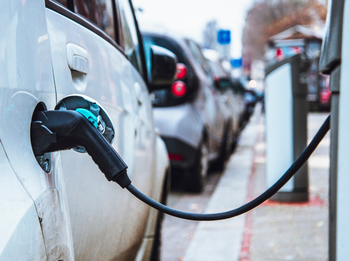 Electric cars being charged in a street. Photo: iStock
