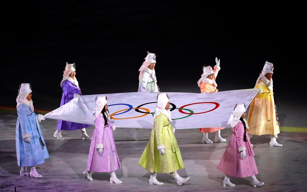 The Olympic flag is paraded during the opening ceremony. Photo: Reuters/Phil Noble