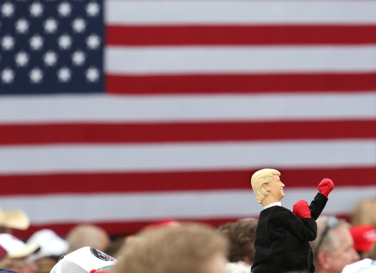 A supporter of Donald Trump holds up a boxing hand-puppet in his likeness during a campaign stop inside a hangar at Lakeland Linder Regional Airport in Lakeland, Florida, on October 12, 2016. Photo: AFP / Gregg Newton