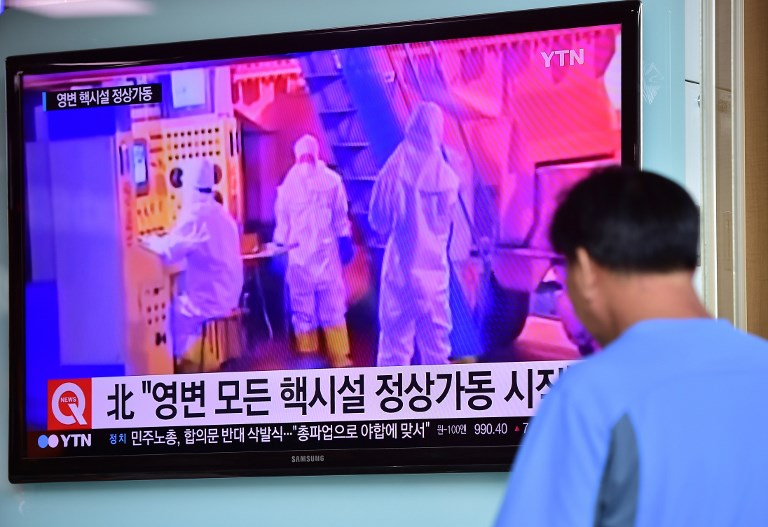 A screen several years ago displaying a news report on North Korea resuming operations at a nuclear reactor in Yongbyon. Photo: AFP/Jung Yeon-je
