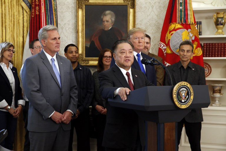 Broadcom CEO Hock Tan in the Oval Office announcing his company is moving its headquarters from Singapore to the US. Photo: AFP/Martin Simon