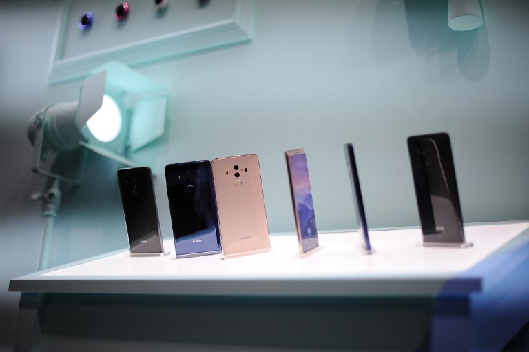 Huawei's flagship Mate handsets: not coming to a store near Americans soon. Photo: NurPhoto via Reuters/Joan Cros