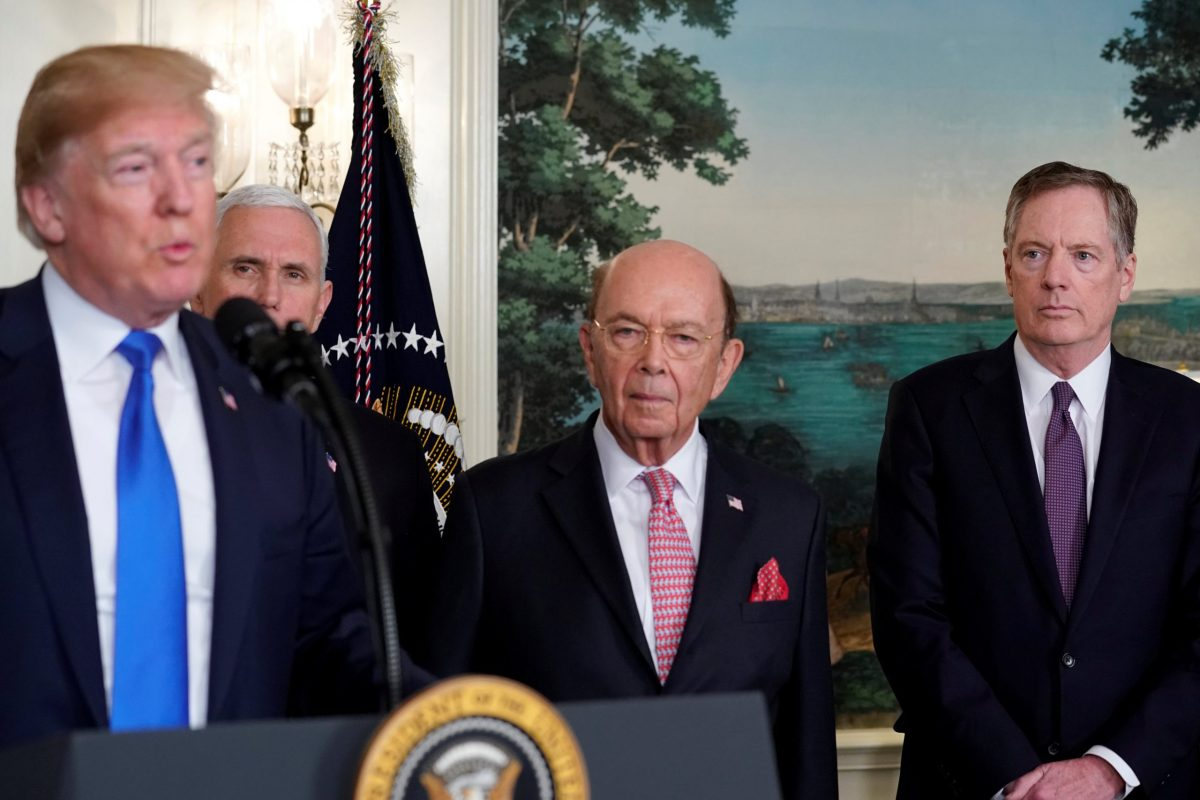 US President Donald Trump, flanked by ‪Vice-President Mike Pence‬, Commerce Secretary Wilbur Ross and US Trade Representative Robert Lighthizer. Photo: Rueters/Jonathan Ernst