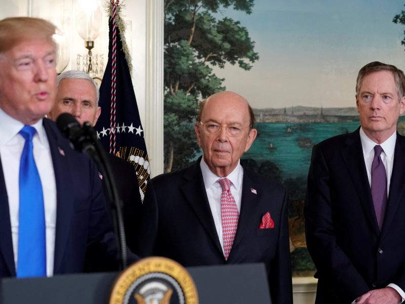 US President Donald Trump, flanked by Vice-President Mike Pence, Commerce Secretary Wilbur Ross and US Trade Representative Robert Lighthizer. Photo: Rueters/Jonathan Ernst