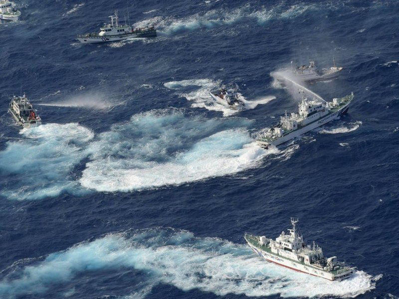 A file photo shows Japanese coastal guard vessels repelling fishing boats using water cannons. Photo: AFP/Getty Images