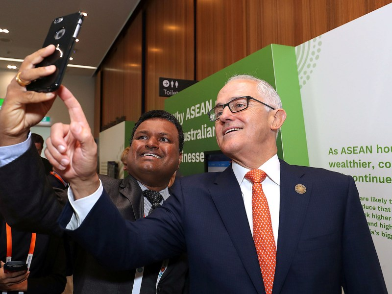 Australian Prime Minister Malcolm Turnbull takes a selfie with a delegate during during a summit event with the 10-member Association of Southeast Asian Nations (Asean) in Sydney, March 16, 2018. Photo: Pool via Reuters/Mark Metcalfe