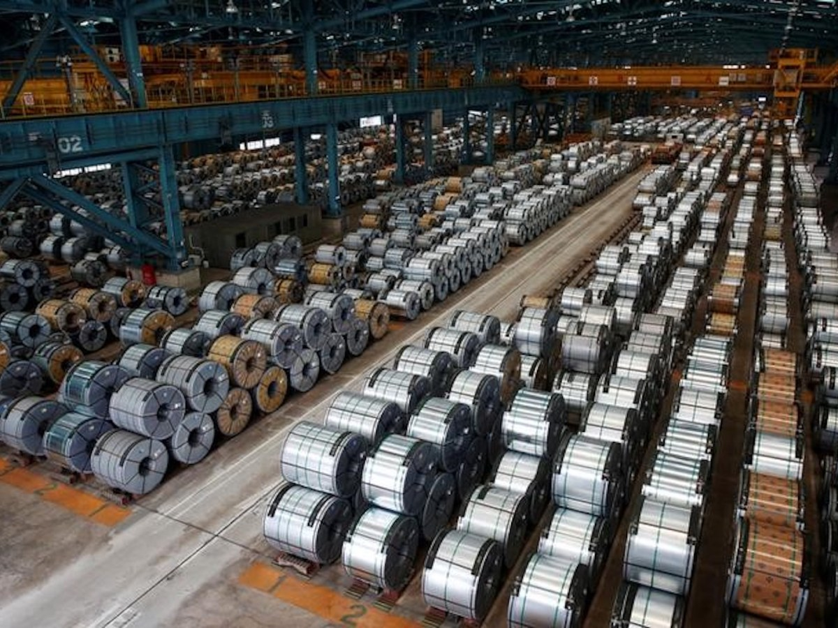 Rolls of steel are stacked inside the China Steel Corporation factory. Photo: Reuters / Tyrone Siu