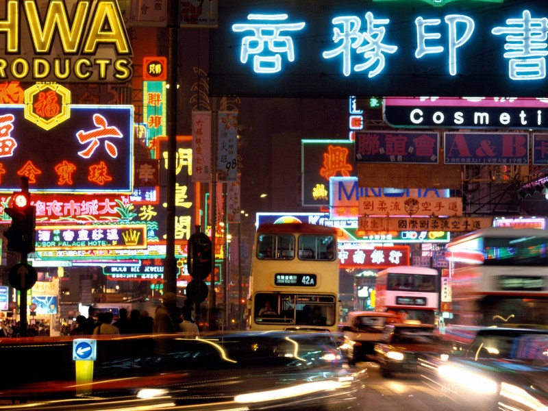 Backed up traffic bathe in the glow of neon lights in  Hong Kong. Photo: iStock