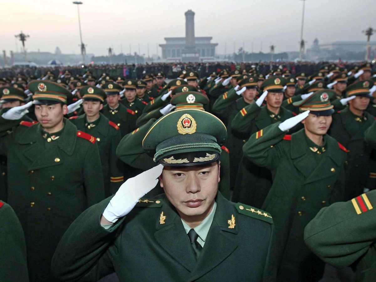 A detachment of the Chinese People's Armed Police responsible for the security of Tiananmen Square and the Forbidden City attend a ceremony to mark the handover of guard duties in Beijing in 2009. Photo: AFP