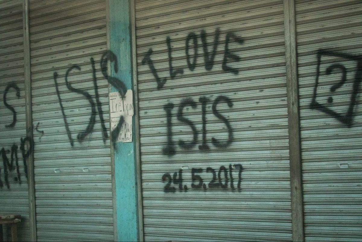 "Abandoned house vandalized with ""I LOVE ISIS"" graffiti in Marawi, southern Philippines on June 9, 2017. Photo: NurPhoto via AFP/Richard Atrero de Guzman"