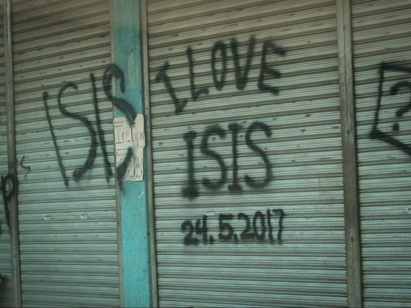 "Abandoned house vandalized with ""I LOVE ISIS"" graffiti in Marawi, southern Philippines on June 9, 2017. Photo: NurPhoto via AFP/Richard Atrero de Guzman"