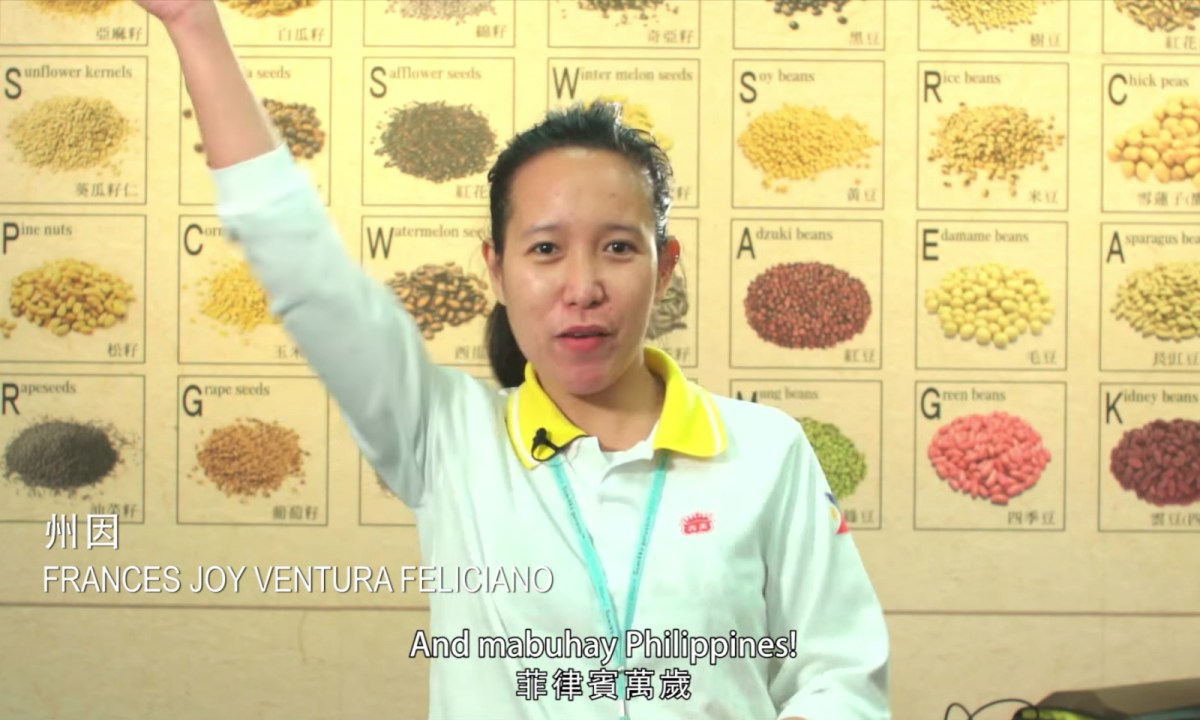 A Filipino working in Taiwan cheers for the Philippines. Photo: YouTube / Taiwan News