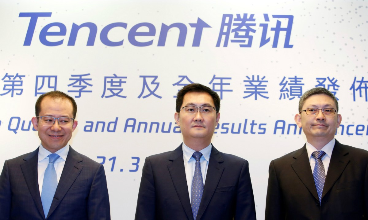 Tencent Holdings president and executive director Martin Lau, chairman and CEO Pony Ma and CFO John Lo (from left) pose after announcing the group's annual results in Hong Kong on March 21, 2018. Photo: Reuters