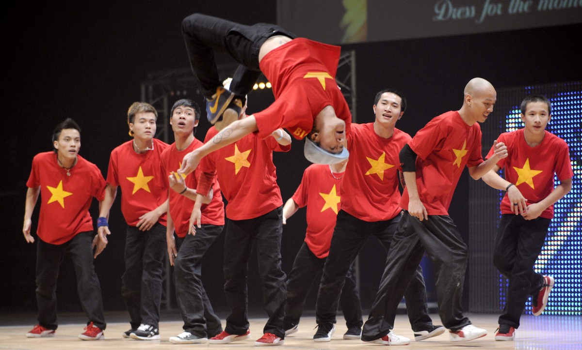 """Members of Big Toe crew from Vietnam perform during the first part of the """"Battle of the Year"""", an international competition of breakdance (Boty), in Montpellier. Photo: AFP/Anne-Christine Poujoulat"""