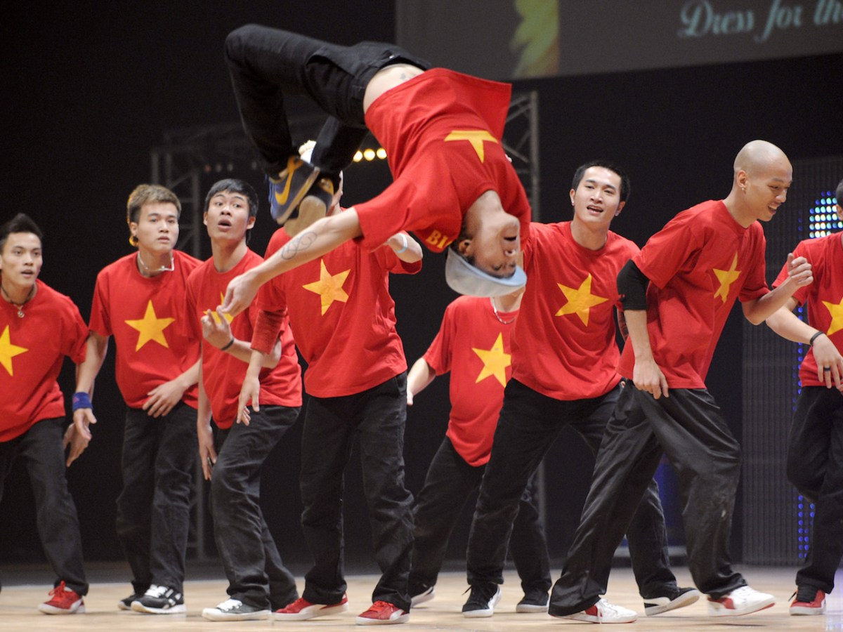 "Members of Big Toe crew from Vietnam perform during the first part of the ""Battle of the Year"", an international competition of breakdance (Boty), in Montpellier. Photo: AFP/Anne-Christine Poujoulat"