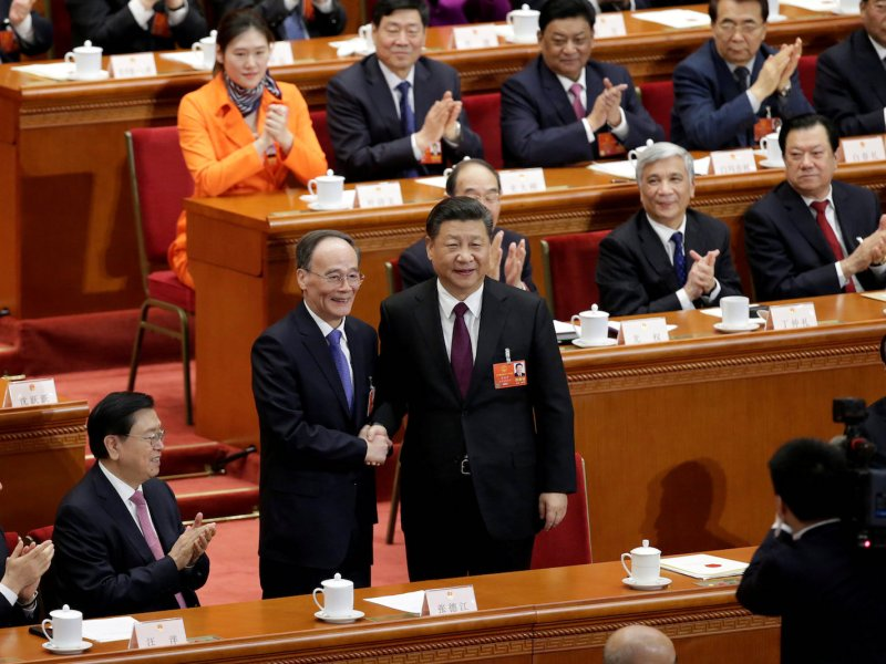 Newly elected Chinese Vice-President Wang Qishan shakes hands with President Xi Jinping at the National People's Congress in Beijing. Photo: Reuters/Jason Lee