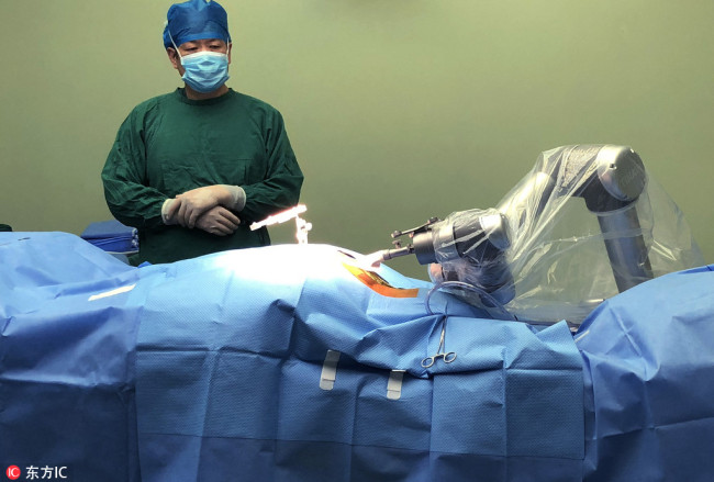 Another robot is seen performing an orthopedic survey in a hospital in China's Hefei city. Photo: CRI
