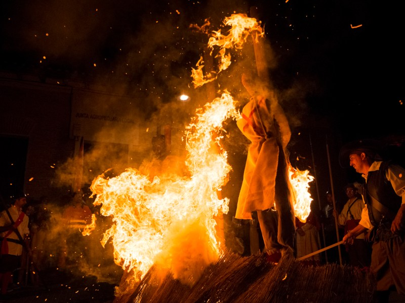 Medina del Campo, Spain - August 17, 2013: Several people take part in a reenactment of a burning witches. Photo: iStock
