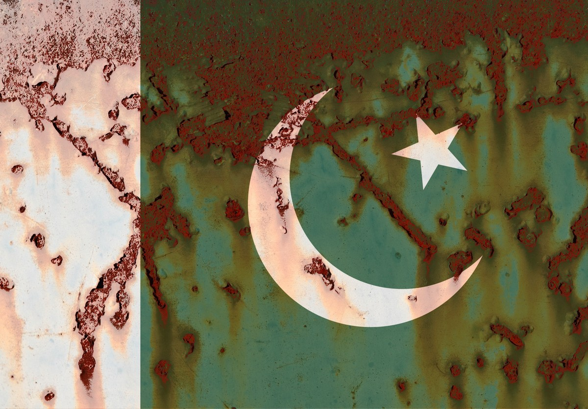 Flag of  Islamic Republic of Pakistan at the rusty background. Photo: iStock