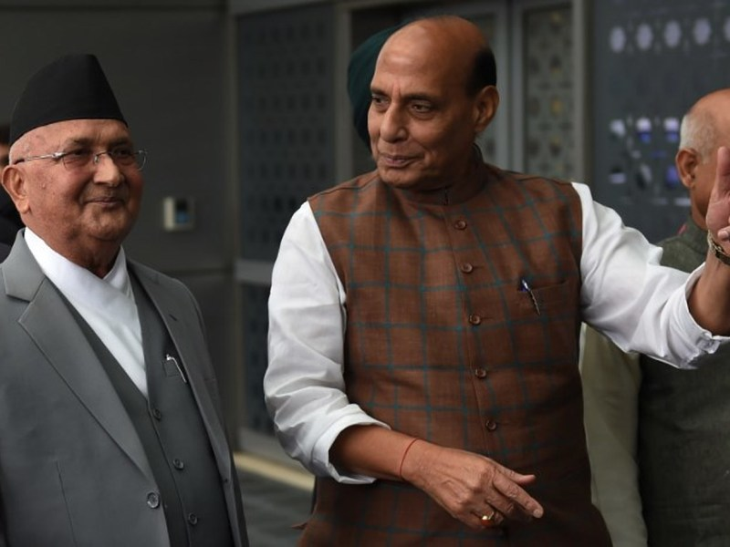 Nepali Prime Minister K.P. Sharma Oli (L) with Indian Home Minister Rajnath Singh after his arrival at Indira Gandhi international airport in New Delhi on Friday. Photo: AFP/MONEY SHARMA