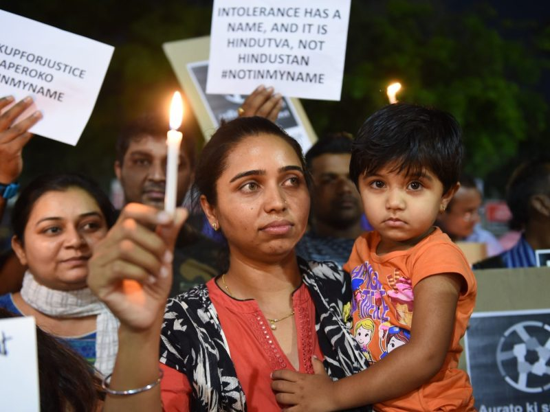 Protesters hold a candle-light vigil in Ahmedabad, in support of rape victims following horrific attacks in Jammu and Uttar Pradesh. Photo: AFP/ Sam Panthaky