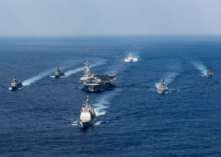The USS Carl Vinson aircraft carrier with Japan Maritime Self-Defense Force destroyers conducting an exercise in the Philippine Sea in February 2018. Photo: US Navy via AFP