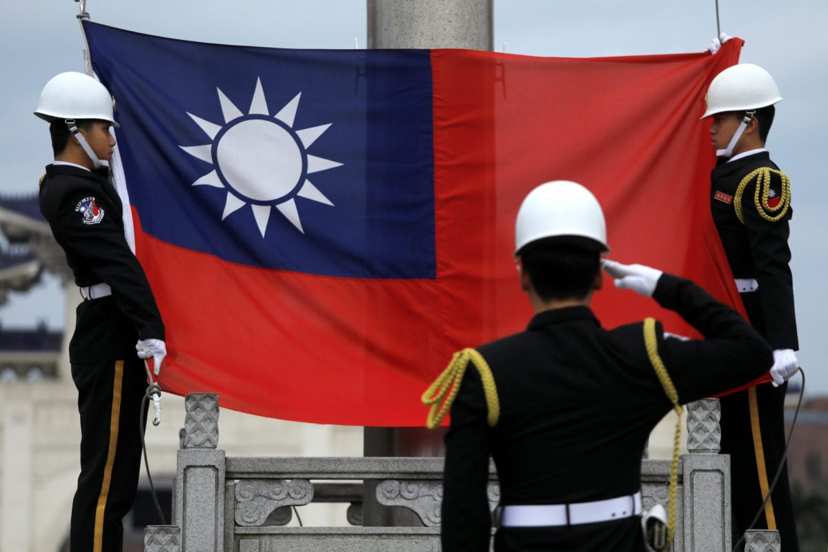 Military honor guards attend a flag-raising ceremony at the Chiang Kai-shek Memorial Hall in Taipei on March 16, 2018. Photo: Reuters/Tyrone Siu