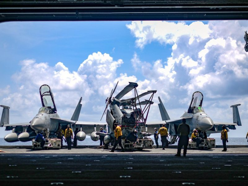 US sailors aboard the aircraft carrier USS Theodore Roosevelt in the South China Sea on April 8, 2018. Photo: US Navy via Reuters/Michael Hogan