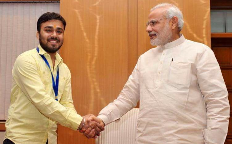 Abhishek Mishra shakes hands with Prime Minister Narendra Modi. Photo: Facebook