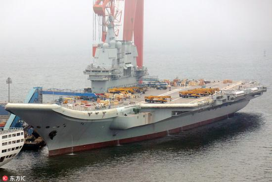 China's first homemade carrier has embarked on a sea trial. It is expected to be delivered to the navy by the end of the year. Photo: People's Daily via DFIC