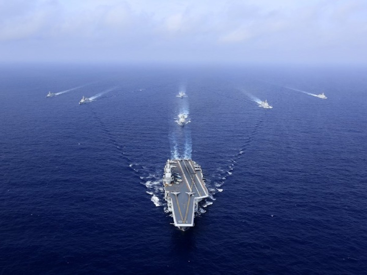 An aerial view China's aircraft carrier, Liaoning, followed by destroyers and frigates during an exercise this month. Photo: AFP