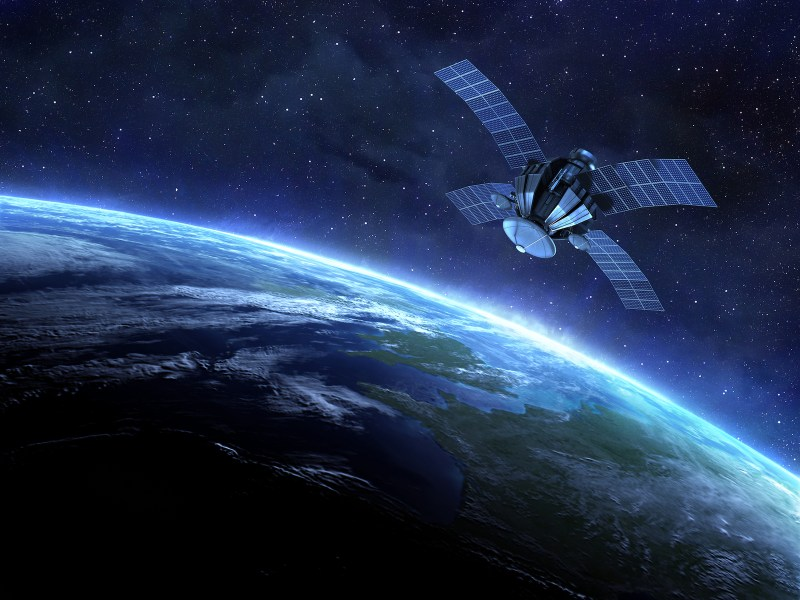 A satellite in orbit above the Earth. Photo: iStock/Getty Images