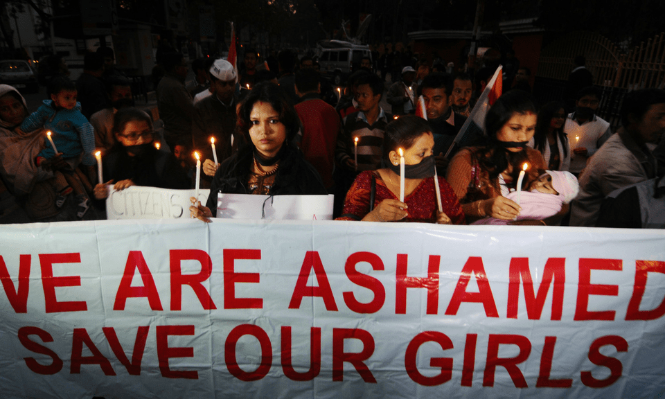Protesters hold a candlelight march against crimes against women in Assam. Photo: AFP