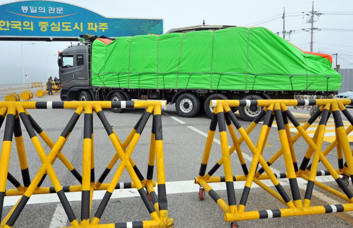 South Korean trucks carrying flour for North Korean flood victims drive past a military checkpoint near the inter-Korean border in 2012. Photo: AFP/Jung Yeon-Je