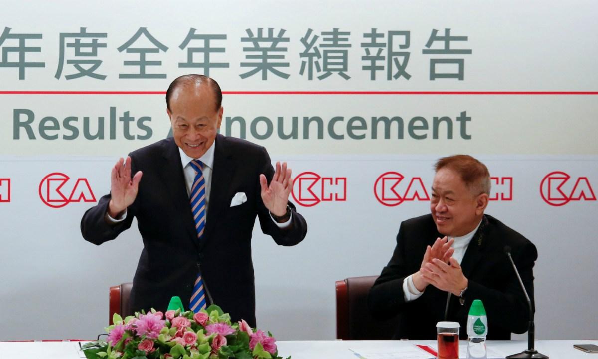 Hong Kong tycoon Li Ka-shing (left), with Canning Fok Kin-ning, announces his retirement in Hong Kong in March. Photo: Reuters/Bobby Yip