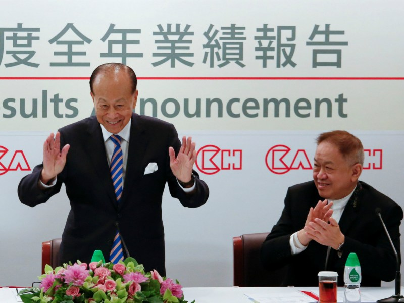 Hong Kong tycoon Li Ka-shing (left), with Canning Fok Kin-ning, announces his retirement in Hong Kong in March. Photo: Reuters/Bobby Yip