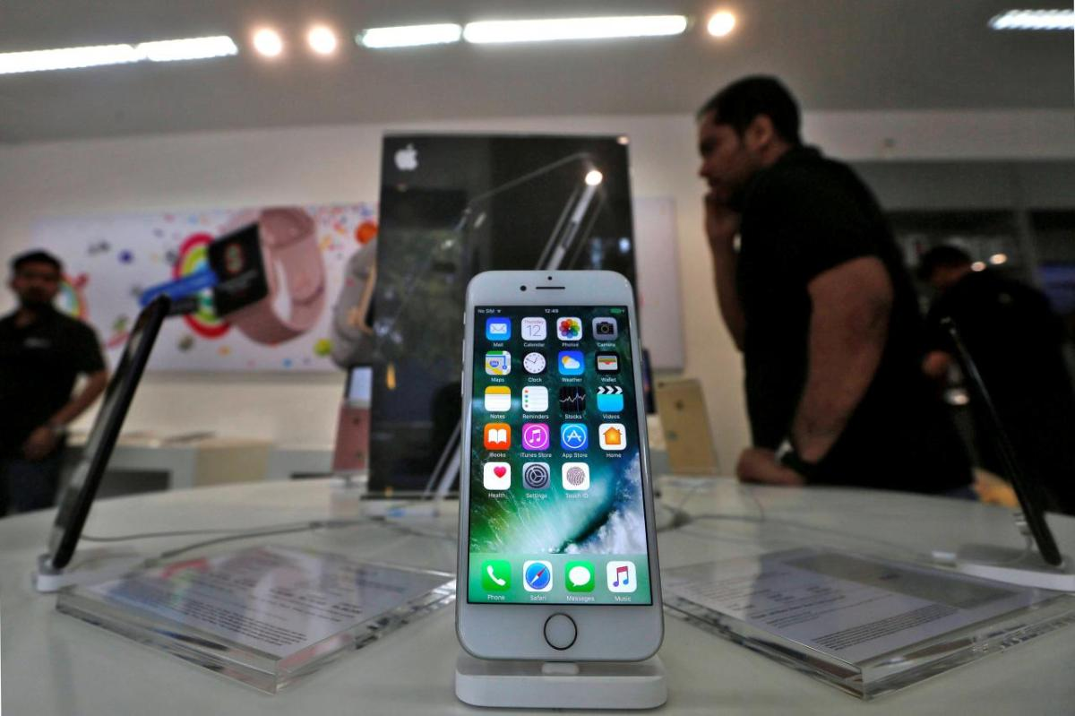 An iPhone is seen on display at a kiosk at an Apple reseller store in Mumba: REUTERS