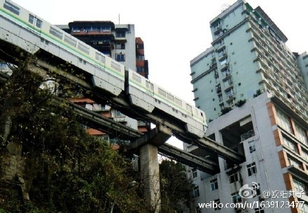 A train on Chongqing's Line 2 seen approaching the Liziba station which is built inside a residential tower. PHOTO: Weibo