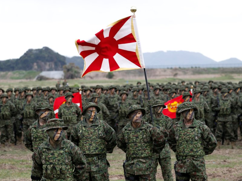 Troops of the Japanese Ground Self-Defense Force's Amphibious Rapid Deployment Brigade, Japan's first marine unit since World War II, gather at a ceremony activating the brigade at Camp Ainoura in Sasebo, on the island of Kyushu. Photo: Reuters / Issei Kato
