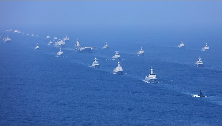 The Chinese carrier Liaoning, escorted by destroyers, frigates and other warships, is seen in a parade off Hainan on Thursday. Photo: Xinhua