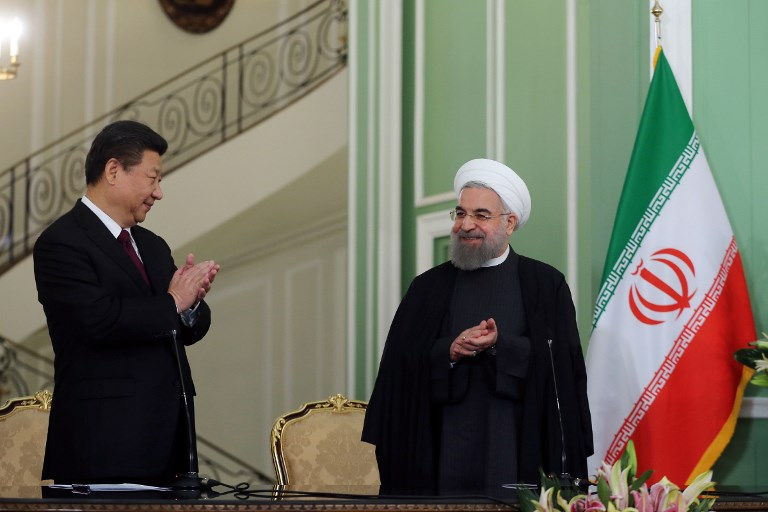 Chinese President Xi Jinping with Iranian President Hassan Rouhani. Photo: AFP