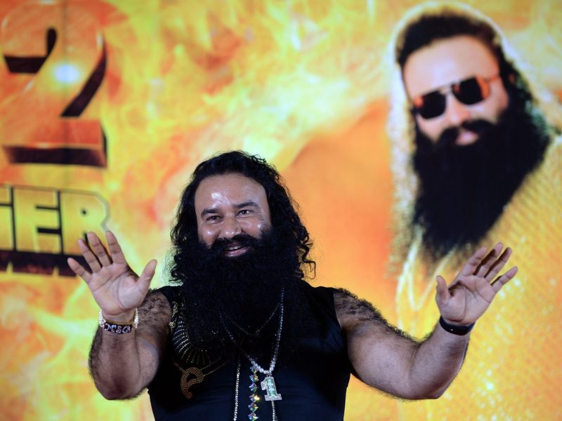 Indian chief of the religious sect Dera Sacha Sauda (DSS) Gurmeet Ram Rahim Singh gestures during a news conference to launch the score for his film 'MSG-2 The Messenger'. Photo: AFP/ Punit Paranjpe