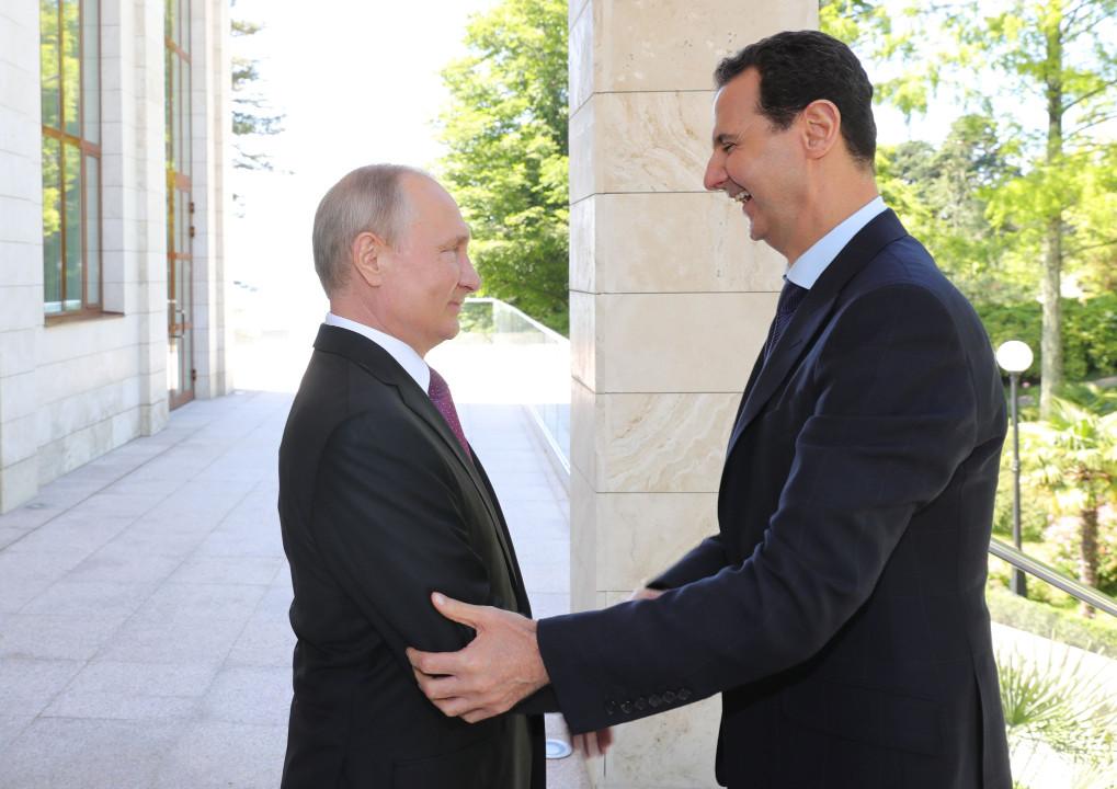 Russian President Vladimir Putin welcomes Syrian President Bashar al-Assad in May 2018. Photo: Sputnik via Reuters/ Mikhail Klimentyev
