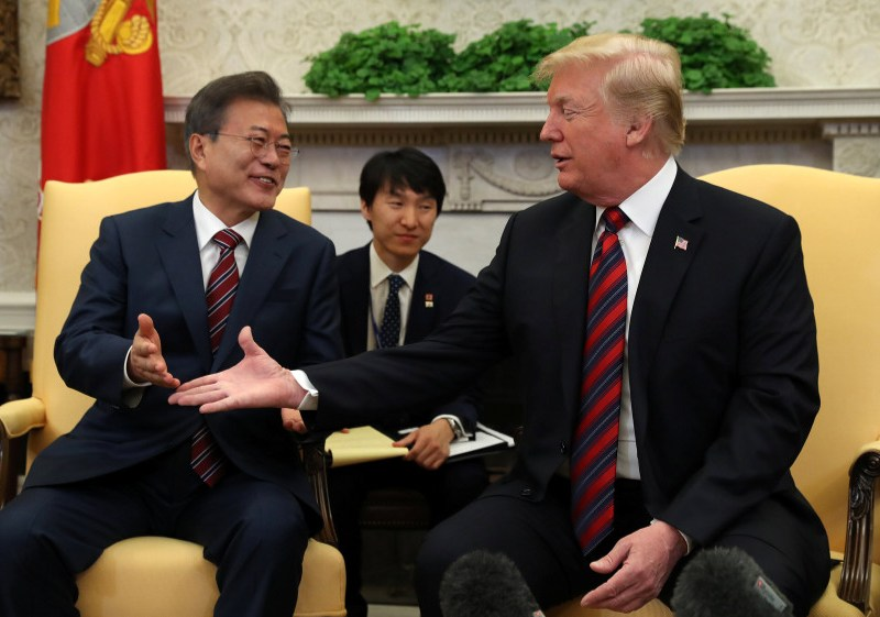 US President Donald Trump welcomes South Korean President Moon Jae-In in the Oval Office on Tuesday. Photo: Reuters/Kevin Lamarque