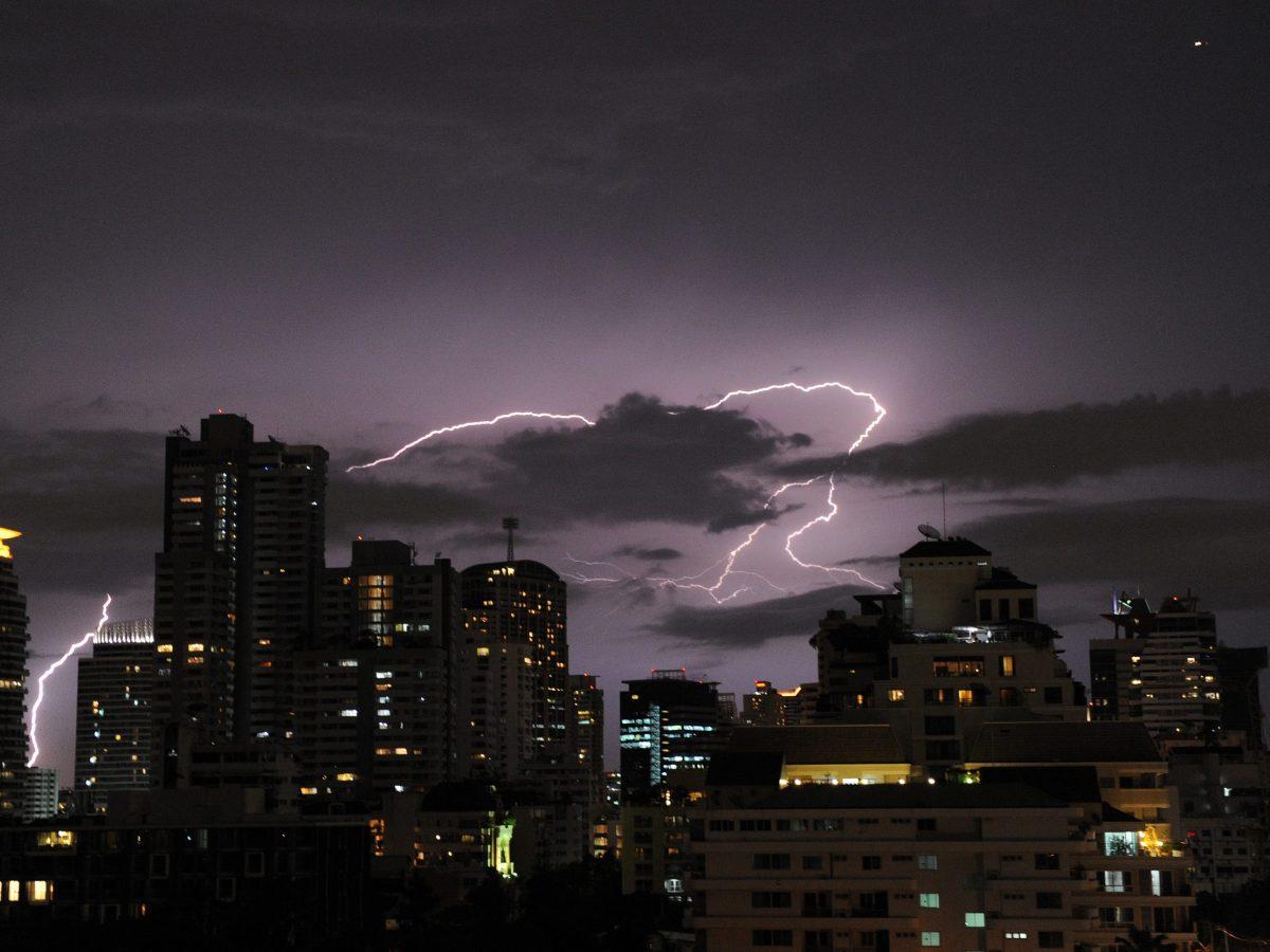 Lightning striking over Bangkok's skyline. Photo: AFP/Christophe Archambault