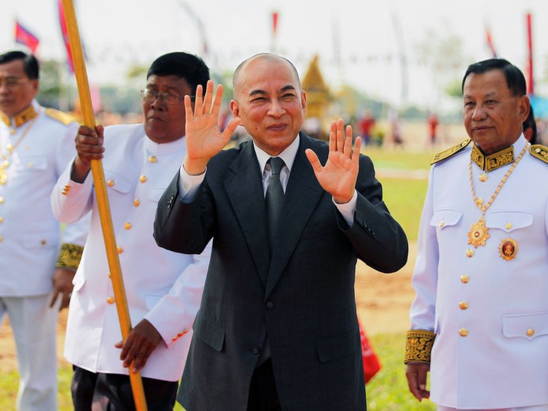 Cambodia's King Norodom Sihamoni greets people as he attends a royal plowing ceremony in Svay Rieng province, Cambodia, May 3, 2018. Photo: Reuters/Stringer